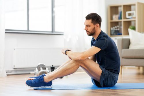 Man Sitting on Exercise Mat