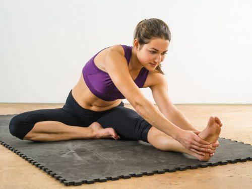 Women Stretching On Mat