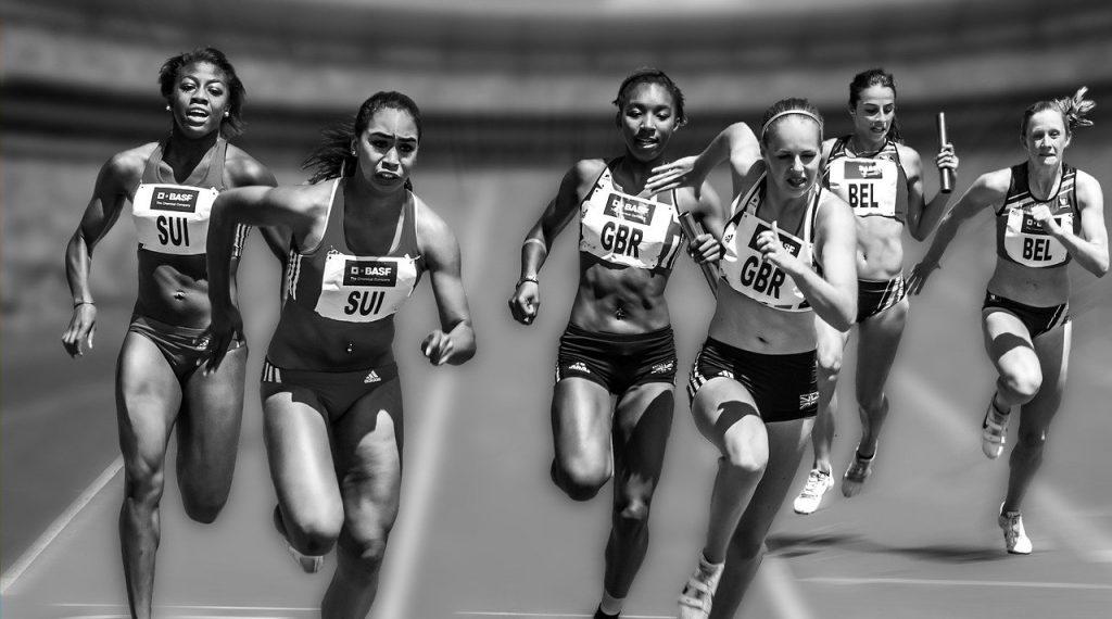 Girls running race track
