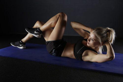 Women Exercising On Ground